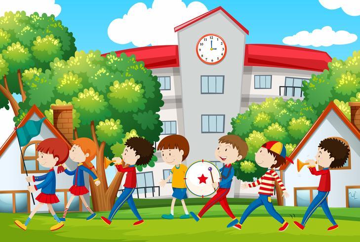 Skolbandet marscherar framför skolan