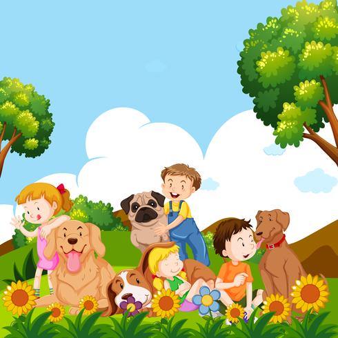 Crianças e cães de estimação no jardim