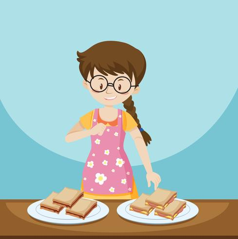 Girl and two plates of sandwiches