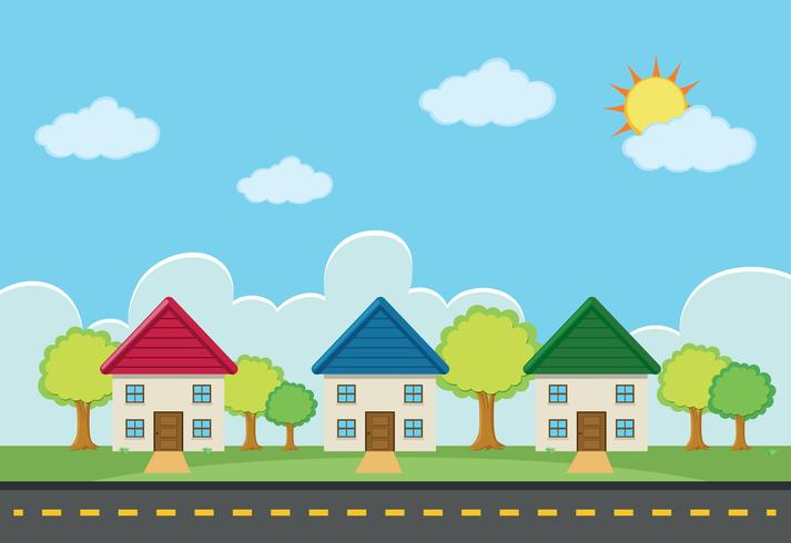 Szene mit drei Häusern entlang der Straße