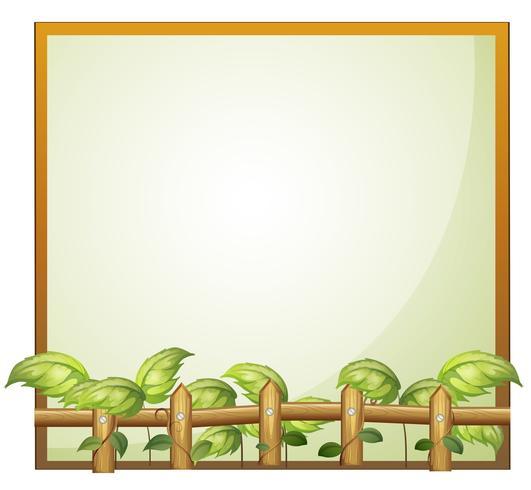 Un cadre vide avec une clôture en bois et des plantes de vigne