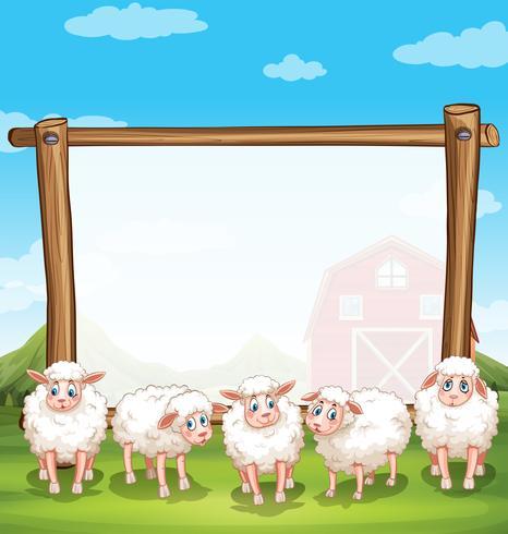 Marco de madera con ovejas en la finca.