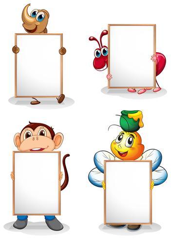 Quatre tableaux blancs devant les quatre animaux vecteur