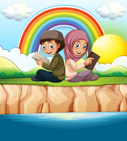 Muslim boy and girl reading book