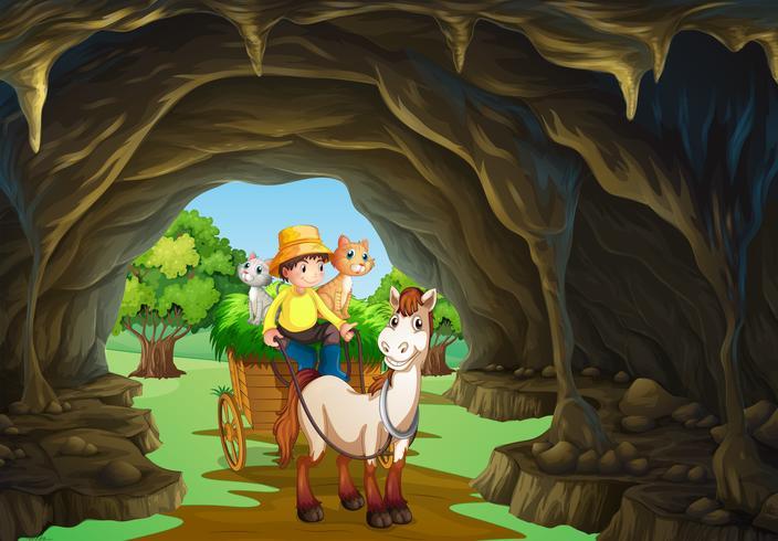 Man som kör vagn genom grottan
