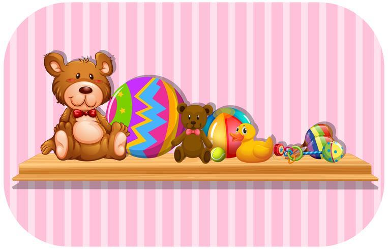 Teddy bears and balls on shelf