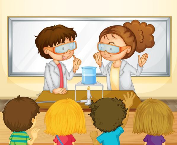 Studenter gör vetenskapliga experiment i klassrummet