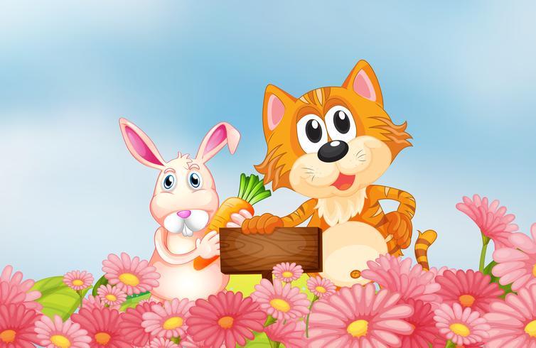 Un conejito sosteniendo una zanahoria y un gato sosteniendo un letrero vacío