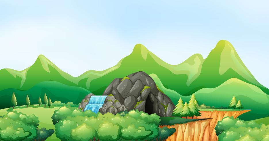 Scena della natura con cascata e grotta vettore