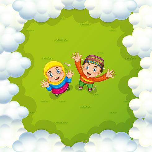 Two muslim kids waving hands