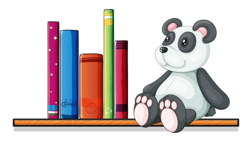 Un estante con libros y un panda de juguete.