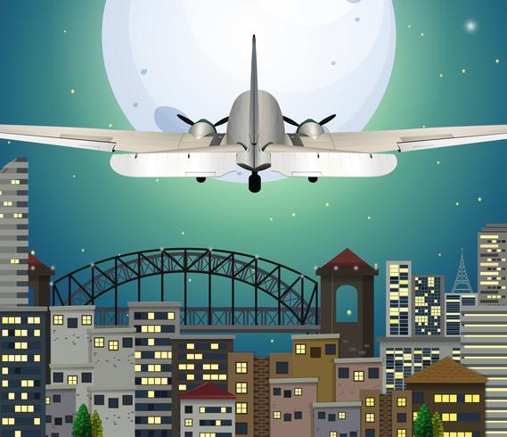 Avión sobrevolando ciudad urbana