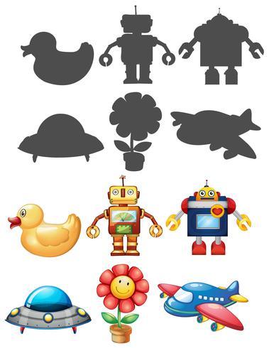 Diferentes juguetes y silueta sobre fondo blanco