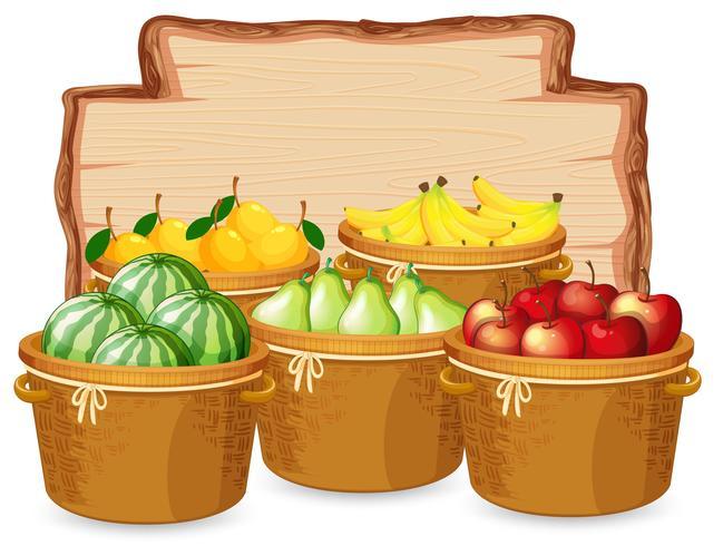 Muchas frutas sobre tabla de madera