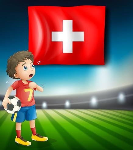Flagge der Schweiz und Fußballspieler