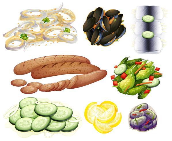 Mat och grönsaker på vit bakgrund