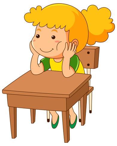 Mädchen, das auf hölzernem Schreibtisch sitzt