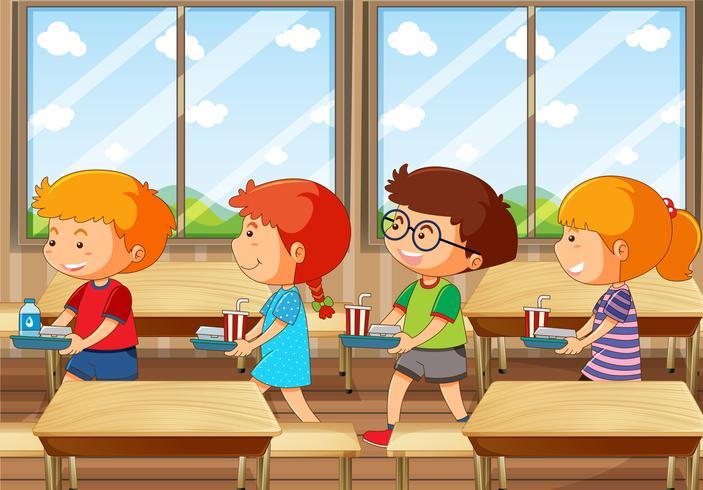 Quattro bambini con vassoio di cibo in mensa