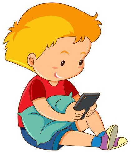 En pojke som spelar mobiltelefon