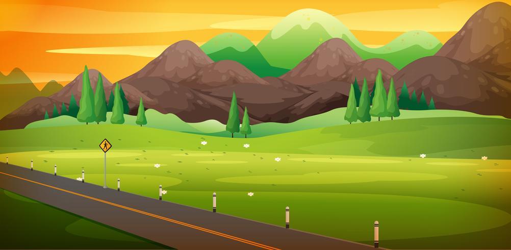 Camino de campo con hermosa escena de montaña