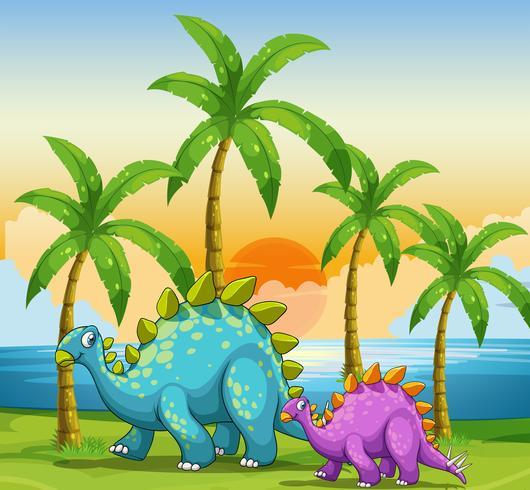 Dinosaurussen bij zonsondergang op het strand