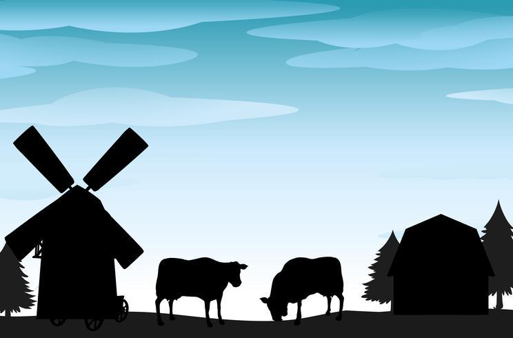 Scena silhouette con mucche e fienili
