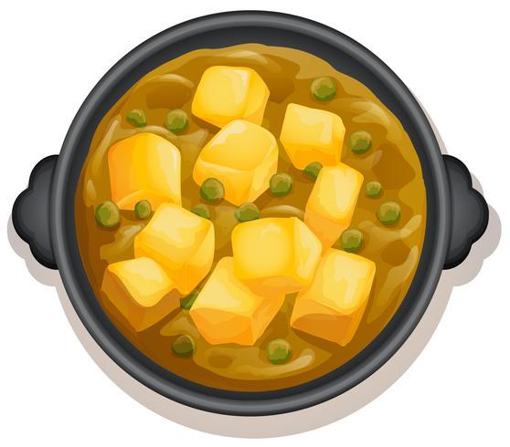 Un curry jaune sur un plat chaud