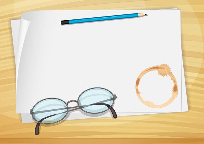 Un papier de liaison vide avec un crayon, une lunette et une tache de café