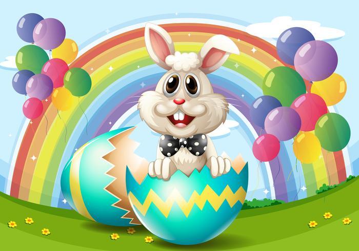 Conejito de Pascua con huevo y globos.
