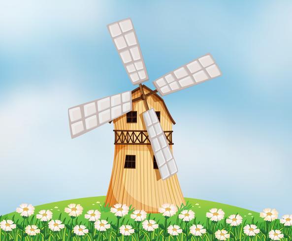 Un granero con un molino de viento.