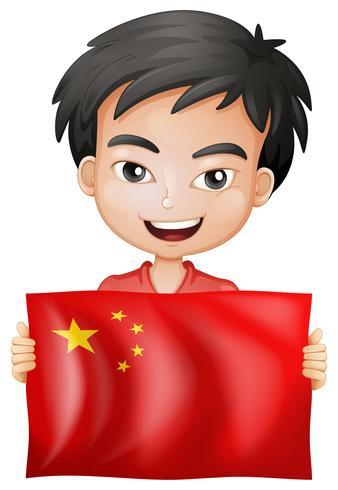 Glücklicher Junge und Flagge von China