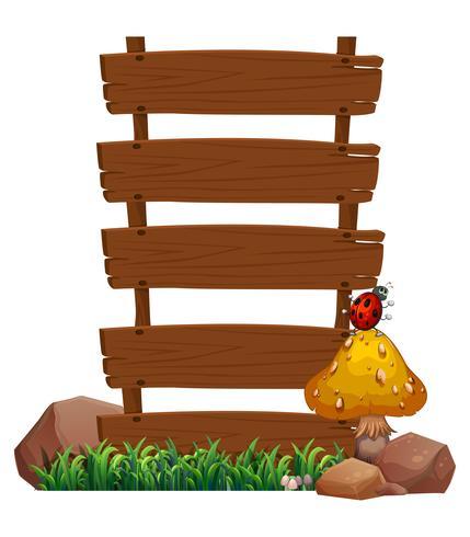 Un'insegna di legno vuota con un insetto nella parte superiore del fungo