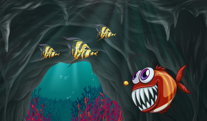 Peces nadando bajo el mar vector
