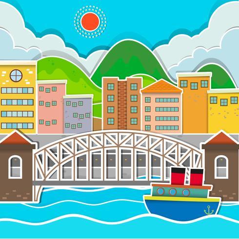 Escena de la ciudad con puente y río