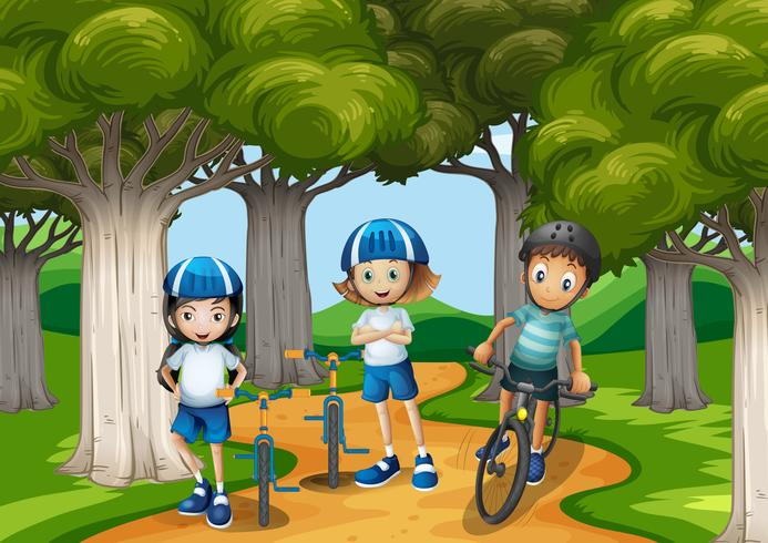 Tres niños montando bicicleta en el parque vector