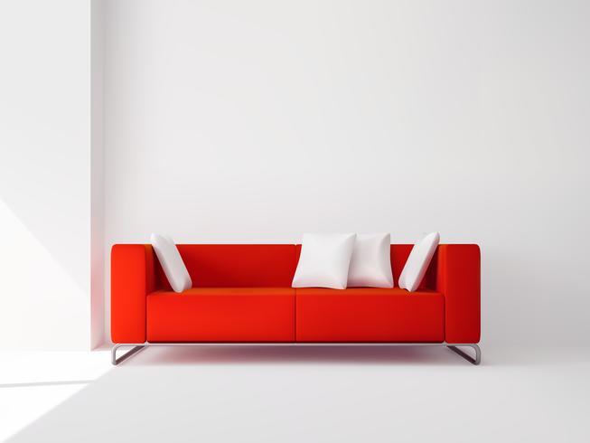 Sofá rojo con almohadas blancas