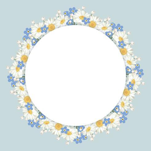 Marco de flores de manzanilla y nomeolvides sobre fondo azul vintage