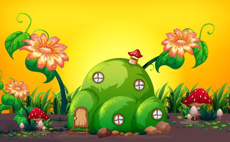 Maison de fée verte colline dans la nature