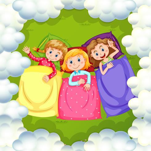 Tre tjejer sover på gräset