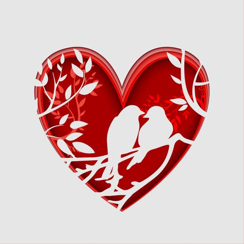 Papier d'art d'oiseaux sur une branche d'arbre en forme de coeur, concept origami. La Saint Valentin.