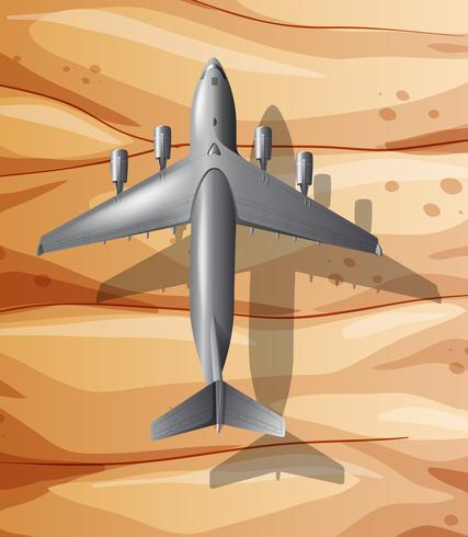 Un aeroplano che sorvola il deserto