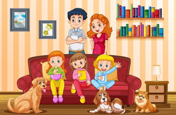 Famiglia con tre ragazze e cani in soggiorno