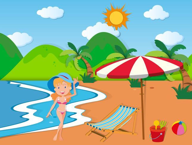 Kvinna i bikini på stranden vektor