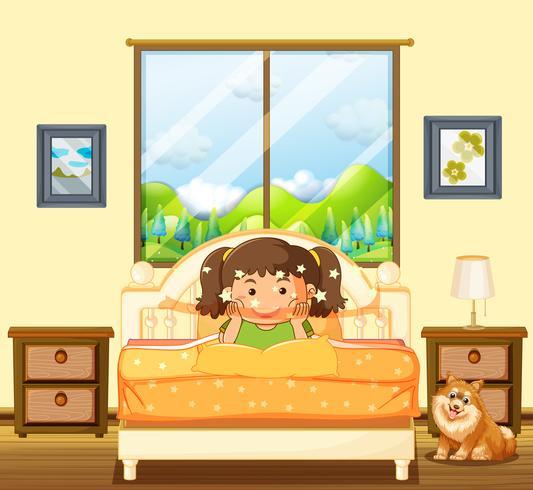 Bambina in camera da letto con cane