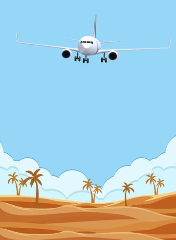 Een vliegtuig dat over woestijn vliegt