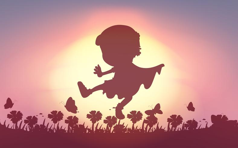Silhouette of boy playing in the field