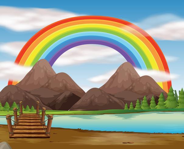Scène met regenboog over de rivier