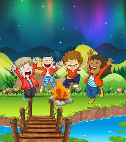 Barn camping ut vid floden