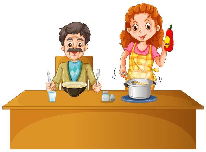 Vater und Mutter, die Mahlzeit auf dem Tisch haben