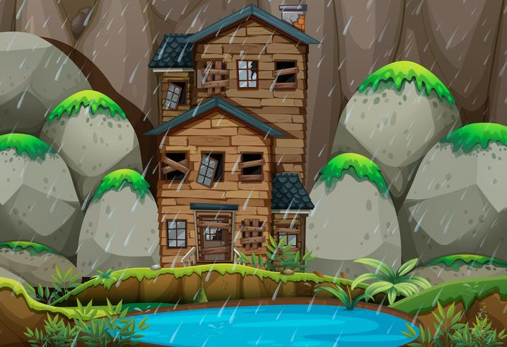 Ruined house by the pond in rainny season